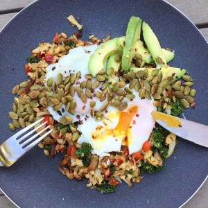 Panfried cauli rice with veggies, poachies, avo and spiced pumpkin seeds