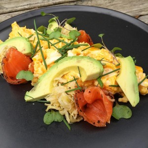 Smoked salmon with scrambled eggs, avocado & fresh herbs