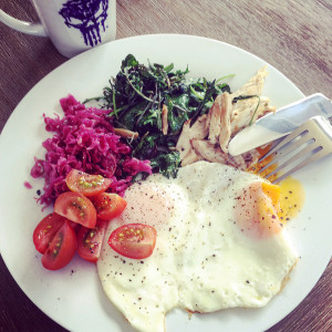 Leftover chicken, sauerkraut, fried eggs, kale & cherry toms